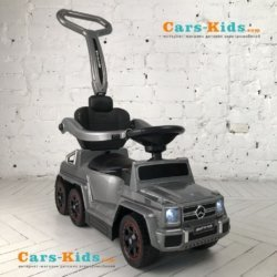 Электромобиль-каталка Mercedes-Benz G63 AMG 6x6 серый (педаль газа, музыка, свет фар, резиновые колеса, мягкое сиденье)